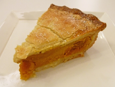 Pies & Coffee's pumpkin pie crust borrows a line from shortbread and flirts with butter, and its filling beckons from beneath.